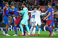 20th September 2021; Nou Camp, Barcelona, Spain; La Liga football league, FC Barcelona versus Granada CF;  Ronald Araujo of FC Barcelona and Domingos Duarte get into an physical argument during the Liga match between FC Barcelona and Granada CF .