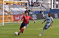 KANSAS CITY, KS - SEPTEMBER 19: Bressan #4 of FC Dallas clears the ball as Gadi Kinda #17 of Sporting Kansas City looks on during a game between FC Dallas and Sporting Kansas City at Children's Mercy Park on September 19, 2020 in Kansas City, Kansas.