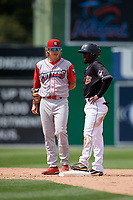 Williamsport Crosscutters shortstop Bryson Stott (15) talks with base runner Milton Smith II (33) during a NY-Penn League game against the Batavia Muckdogs on August 27, 2019 at Dwyer Stadium in Batavia, New York.  Williamsport defeated Batavia 11-4.  (Mike Janes/Four Seam Images)