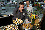 Daya Myers-Hurt and Sharon Gofreed from State of Grace set up the desserts at the Saks Fifth Avenue Key to the Cure Wednesday Oct. 26,2016.(Dave Rossman photo)