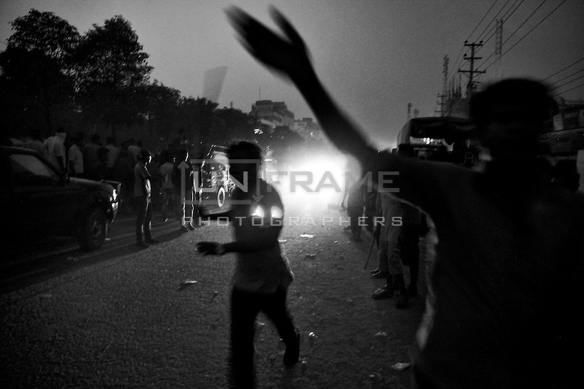 Local people are clearing the road for ambulance after the Rana plaza collapse. Savar, near Dhaka, Bangladesh