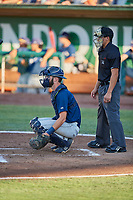 David Fry (5) of the Helena Brewers on defense against the Ogden Raptors at Lindquist Field on July 14, 2018 in Ogden, Utah. Umpire John Perez handles the calls behind the plate.  Ogden defeated Helena 8-6. (Stephen Smith/Four Seam Images)