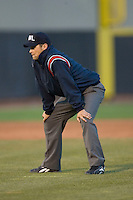 Umpire Matt Benham works the bases during a Midwest League game between the Great Lakes Loons and the Dayton Dragons at Fifth Third Field April 22, 2009 in Dayton, Ohio. (Photo by Brian Westerholt / Four Seam Images)