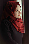 A girl wearing veil (hijab) with a meditation look. Photo by Sanad Ltefa