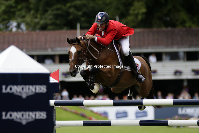 August 09, 2009: Charlie Jayne (USA) aboard Athena competing in the Grand Prix event. Longines International Grand Prix. Failte Ireland Horse Show. The RDS, Dublin, Ireland.