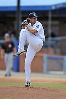 Asheville Tourists starting pitcher Alex Balog #34 delivers a pitch during a game against the  Delmarva Shorebirds at McCormick Field on April 6, 2014 in Asheville, North Carolina. The Shorebirds defeated the Tourists 4-2. (Tony Farlow/Four Seam Images)