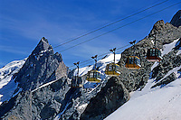 Overhead cable cars going up to the summit of La Meije in the French Alps, France.