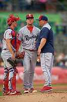Reading Fightin Phils pitching coach Aaron Fultz (44) talks with pitcher Bailey Falter (33) and catcher Austin Bossart (18) during an Eastern League game against the Akron RubberDucks on June 4, 2019 at Canal Park in Akron, Ohio.  Akron defeated Reading 8-5.  (Mike Janes/Four Seam Images)