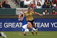 USA's Abby Wambach gets taken down by Finland's Marian Dalmy. The USA women's national team defeated Finland 4-0 at the Home Depot Center in Carson, CA, on August 25, 2007. (Photo by Matt A. Brown/ISIphotos.com)