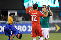 Hector Moreno (15) celebrates with goalkeeper Alfredo Talavera (12) of Mexico after the game.  Mexico defeated Guatemala 2-1 during a quarterfinal match of the 2011 CONCACAF Gold Cup at the New Meadowlands Stadium in East Rutherford, NJ, on June 18, 2011.