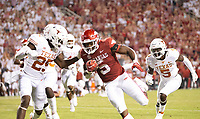 Arkansas RB Raheim Sanders (5)<br /> runs for touchdown with University of Texas DB B. J. Foster(25) trying to make the stop at <br />Donald W. Reynolds Razorback Stadium, Fayetteville, AR, on Saturday, September 11, 2021 /  David Beach