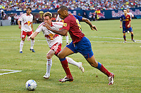 FC Barcelona forward Thierry Henry (14) is marked by New York Red Bulls defender Chris Leitch (33). FC Barcelona defeated the New York Red Bulls 6-2 during an international friendly at Giants Stadium in East Rutherford, NJ, on August 6, 2008.