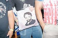 "Carl Hoover, holds a pillow featuring an anime-style drawing of the far-right YouTuber and failed UK political candidate Carl Benjamin, or Sargon Of Akkad, before the start of the Straight Pride Parade in Boston, Massachusetts, on Sat., August 31, 2019. The pillow reads ""Sargon Senpai."""