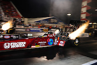 Jun. 15, 2012; Bristol, TN, USA: NHRA top fuel dragster driver Scott Palmer (near lane) races alongside Doug Kal;itta during qualifying for the Thunder Valley Nationals at Bristol Dragway. Mandatory Credit: Mark J. Rebilas-