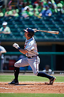 Mississippi Braves right fielder Keith Curcio (14) follows through on a swing during a game against the Montgomery Biscuits on April 25, 2017 at Montgomery Riverwalk Stadium in Montgomery, Alabama.  Mississippi defeated Montgomery 3-2.  (Mike Janes/Four Seam Images)