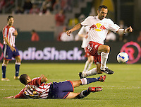 Red Bulls Fwd. Youri Djorkaef leaps over  sliding CD Chivas USA Def. Jason Hernandez  during a 0-0 tie between the Chivas USA vs New York Red Bulls in a MLS game at The Home Depot Center in Carson, California Saturday, April, 29, 2006.