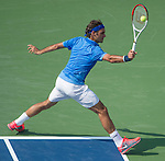 Roger Federer (SUI)  defeats Carlos Berlocq (ARG) at the US Open being played at USTA Billie Jean King National Tennis Center in Flushing, NY on August 29, 2013