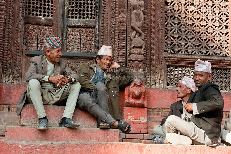 Kathmandu, Nepal.  Nepali men talking on the steps of the Shiva-Parvati Temple, Durbar Square.