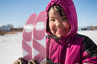 """Danny-Girl"" from Zackar Levi School in Lower Kalskag is joyous after skiing for the first time with Skiku coaches. Skiku is a non-profit organization with the mission of creating a sustainable Nordic ski program in communities throughout Alaska. Volunteer coaches travel to villages each spring to instruct youngsters and distribute donated equipment with the goal of establishing ski programs at rural schools.  Photo by James R. Evans"