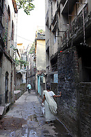 A elderly woman walks through the old backstreets of Kolkata.<br /> <br /> To license this image, please contact the National Geographic Creative Collection:<br /> <br /> Image ID: 1925751 <br />  <br /> Email: natgeocreative@ngs.org<br /> <br /> Telephone: 202 857 7537 / Toll Free 800 434 2244<br /> <br /> National Geographic Creative<br /> 1145 17th St NW, Washington DC 20036