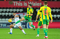 Cameron Carter-Vickers of Swansea City battles with Jay Rodriguez of West Bromwich Albion during the Sky Bet Championship match between Swansea City and West Bromwich Albion at the Liberty Stadium in Swansea, Wales, UK. Wednesday 28 November 2018