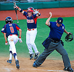 Newtown(CT)'s Ryan Kost is called safe at the plate as Newtown(CT)'s Lucas O'Brien celebrates the run during the Cal Ripken Babe Ruth World Series in Aberdeen, Maryland on August 12, 2012. Newtown(CT) defeated Milialani(HI) 11-8.