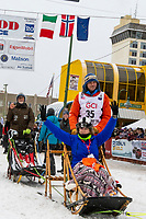Joar Leifseth Ulsom and team leave the ceremonial start line with an Iditarider and handler at 4th Avenue and D street in downtown Anchorage, Alaska on Saturday March 7th during the 2020 Iditarod race. Photo copyright by Cathy Hart Photography.com
