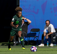 GRENOBLE, FRANCE - JUNE 22: Francisca Ordega #17 of the Nigerian National Team dribbles at midfield during a game between Nigeria and Germany at Stade des Alpes on June 22, 2019 in Grenoble, France.