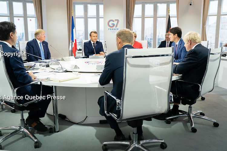 President Donald J. Trump joins G7 Leaders Italian Prime Minister Giuseppe Conte; European Council President Donald Tusk; Japan Prime Minister Shinzo Abe; United Kingdom Prime Minister Boris Johnson; German Chancellor Angela Merkel; Canadian Prime Minister Justin Trudeau and G7 Summit host French President Emmanuel Macron during a G7 Working Session on Global Economy, Foreign Policy and Security Affairs at the Centre de Congrés Bellevue Sunday, Aug. 25, 2019, in Biarritz, France. (Official White House Photo by Shealah Craighead)