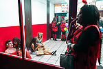 © Joel Goodman - 07973 332324 . 27/12/2017. Wigan, UK. People sit on the floor of a takeaway . Revellers in Wigan enjoy Boxing Day drinks and clubbing in Wigan Wallgate . In recent years a tradition has been established in which people go out wearing fancy-dress costumes on Boxing Day night . Photo credit : Joel Goodman