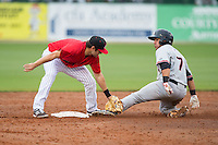 Jose Trevino (7) of the Hickory Crawdads is tagged out at second base by Christian Stringer (9) of the Kannapolis Intimidators at CMC-Northeast Stadium on April 17, 2015 in Kannapolis, North Carolina.  The Crawdads defeated the Intimidators 9-5 in game one of a double-header.  (Brian Westerholt/Four Seam Images)