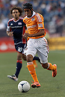 Houston Dynamo midfielder Calen Carr (3) on the attack. In a Major League Soccer (MLS) match, the New England Revolution tied Houston Dynamo, 2-2, at Gillette Stadium on May 19, 2012.