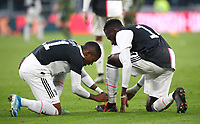 Calcio, Serie A: Juventus - Cagliari, Turin, Allianz Stadium, January 6, 2020.<br /> Juventus' Douglas Costa (l) ties Blaise Matuidi (r) shoes during the Italian Serie A football match between Juventus and Cagliari at Torino's Allianz stadium, on January 6, 2020.<br /> UPDATE IMAGES PRESS/Isabella Bonotto