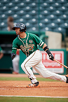 Greensboro Grasshoppers third baseman J.C. Millan (14) follows through on a swing during a game against the Lakewood BlueClaws on June 10, 2018 at First National Bank Field in Greensboro, North Carolina.  Lakewood defeated Greensboro 2-0.  (Mike Janes/Four Seam Images)