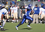 Carson's Seamus Burns runs against Reed during the NIAA D-1 Northern Regional title game at Bishop Manogue High School in Reno, Nev., on Saturday, Nov. 29, 2014. Reed won 28-25.<br /> Photo by Cathleen Allison