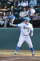 Ty Moore #29 of the UCLA Bruins bats against the Cal Poly Mustangs at Jackie Robinson Stadium on February 22, 2014 in Los Angeles, California. Cal Poly defeated UCLA, 8-0. (Larry Goren/Four Seam Images)