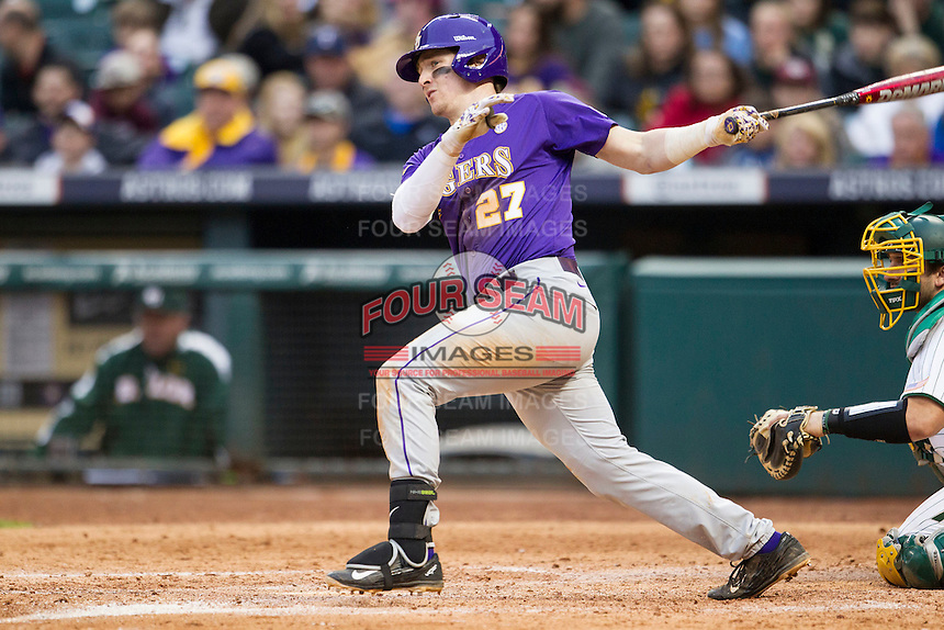 LSU Tigers first baseman Danny Zardon (27) follows through on his swing during the NCAA baseball game against the Baylor Bears on March 7, 2015 in the Houston College Classic at Minute Maid Park in Houston, Texas. LSU defeated Baylor 2-0. (Andrew Woolley/Four Seam Images)
