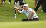 Welsh golfer Phillip Price lines up a birdie putt on the 13th green during the first round of the ISPS Handa Wales Open 2013 at the Celtic Manor Resort<br /> <br /> 29.08.13<br /> <br /> ©Steve Pope-Sportingwales