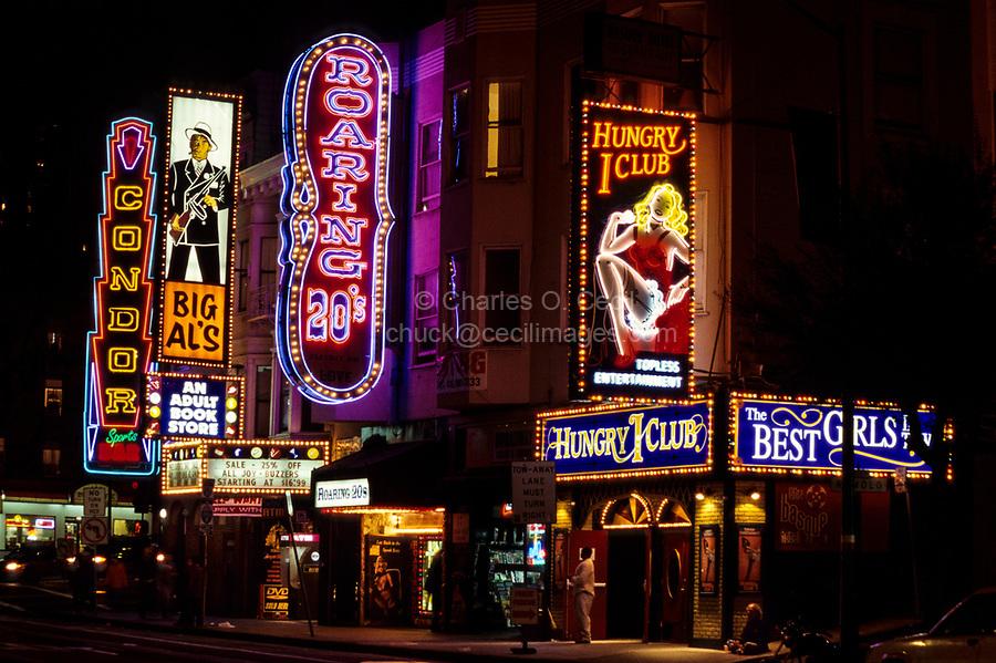 San Francisco, California.  North Beach Neon.  The Hungry i, Big Al's, Condor, Roaring 20s Nightclubs, on Broadway, near Columbus Avenue.