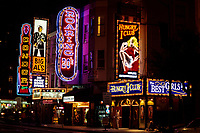 San Francisco, California.  North Beach Neon.  The Hungry i, Big Al's, Condor, Roaring 20s Nightclubs, on Broadway, near Columbus Avenue.