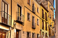 Rustc houses and narrow cobblestone street, Madrid, Spain