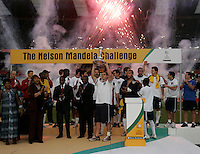 USA's captain Carlos Bocanegra raises the Nelson Mandela challenge trophy after the match between the national teams of South Africa (RSA) and the United States (USA) in an international friendly dubbed the Nelson Mandela Challenge at Ellis Park Stadium in Johannesburg, South Africa on November 17, 2007.