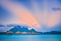 Sunrise and bungalows. Bora Bora. French Polynesia.