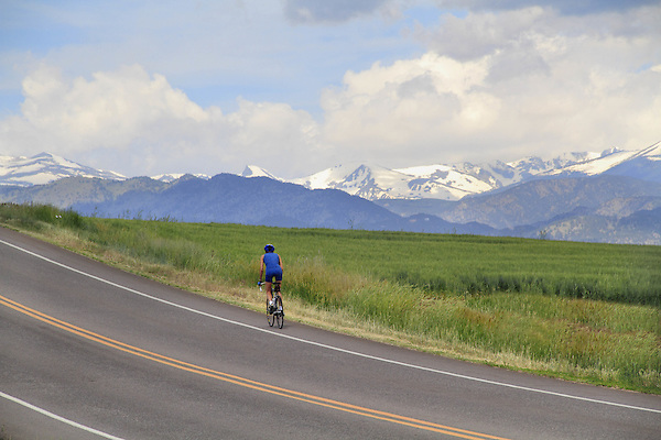 Woman biking uphill, Boulder, COlorado, USA. .  John leads private photo tours in Boulder and throughout Colorado. Year-round. .  John offers private photo tours in Denver, Boulder and throughout Colorado. Year-round.
