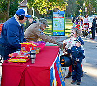 Janelle Jessen/Herald-Leader<br /> J.W. Smith and Larry Buckminster, of American Legion Post 29, pass out candy during the Downtown Trick or Treat on Thursday.