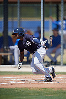 New York Yankees center fielder Tito Polo (4) follows through on a swing during a minor league Spring Training game against the Toronto Blue Jays on March 30, 2017 at the Englebert Complex in Dunedin, Florida.  (Mike Janes/Four Seam Images)