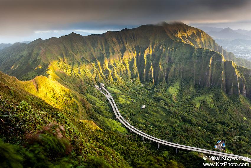 "An aerial view of the Ko'olau mountain range & H-3 freeway in Haiku valley at dawn from Haiku Stairs (""Stairway to Heaven"") hiking trail in Kaneohe, Oahu"