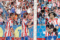 Atletico de Madrid's Cristian Cebolla Rodriguez (l), Filipe Luis (c) and Juanfran Torres celebrate goal during La Liga match.April 14,2013. (ALTERPHOTOS/Acero)