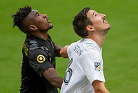 LOS ANGELES, CA - OCTOBER 25: Jose Cifuentes #11 of LAFC and Sacha Kljestan #16 wait patiently for a ball to drop during a game between Los Angeles Galaxy and Los Angeles FC at Banc of California Stadium on October 25, 2020 in Los Angeles, California.