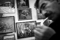 """Nagorny-Karabach, 17.05.2011, Shushi. Maler Hovik Gasparian z¸ndet sich eine Zigarette in seinem Studio an, umgeben von seinen Bildern. """"The Twentieth Spring"""" - ein Portrait der s¸dkaukasischen Stadt Schuschi, 20 Jahre nach der Eroberung der Stadt durch armenische K?mpfer 1992 im B¸gerkrieg um die Unabh?ngigkeit Nagorny-Karabachs (1991-1994). Surrounded by his paintings Artist Hovik Gasparian lights a cigarette to smoke in his studio. """"The Twentieth Spring"""" - A portrait of Shushi, a south caucasian town 20 years after its """"Liberation"""" by armenian fighters during the civil war for independence of Nagorny-Karabakh (1991-1994). .Entouré de ses peintures l'artiste Gasparian Hovik fume une cigarette dans son studio.""""Le Vingtieme Anniversaire"""" - Un portrait de Chouchi, une ville du Caucase du Sud 20 ans après sa «libération» par les combattants arméniens pendant la guerre civile pour l'indépendance du Haut-Karabakh (1991-1994)..© Timo Vogt/Est&Ost, NO MODEL RELEASE !!"""